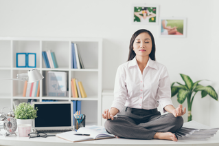 business woman practicing yoga