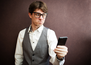 Man Annoyed With Phone