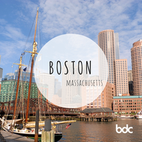 created image of Boston with city and docked boats