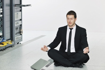 Man in Meditation Pose at Work