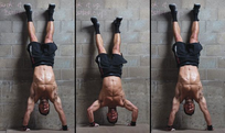 Man doing handstand against a wall